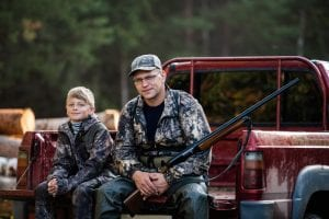 Hunter with his son during the rest sitting inside the pickup truck